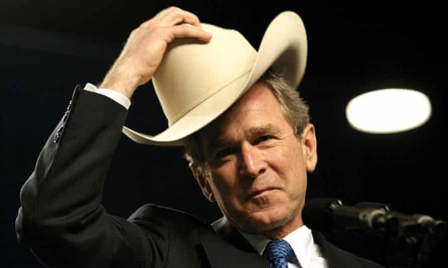 George W. Bush dons a cowboy hat as he speaks at the annual meeting of the cattle industry in 2002.