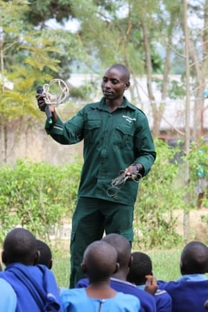 Paul Mugisha talking with Kasiisi Wildlife Club members about snaring.