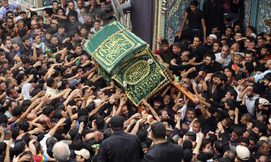 Shia pilgrims carry a symbolic coffin at the holy shrine of Imam Moussa al-Kazim shrine to commemorate his death in the Shia district of Kazimiyah, Baghdad, Iraq, 14 May 2015.