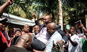 Burundi presidential spokesman Willy Nyamitwe is carried by supporters as people celebrate the return of the President Pierre Nkurunziza in Bujumbura.
