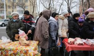 Women queue  in a market in Sovetov square, Kemerovo, Russia