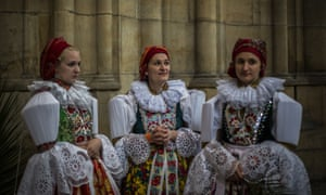Moravian women dressed in national costumes attend the ceremonial holy mass in the St Vitus Cathedral during the Navalis Celebrations in Prague, Czech Republic.