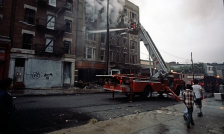 USA, SOUTH BRONX, NEW YORK CITY-AUGUST 1977. New York City Fire Department appliance tackling fire in abandoned tenemant block in South Bronx.