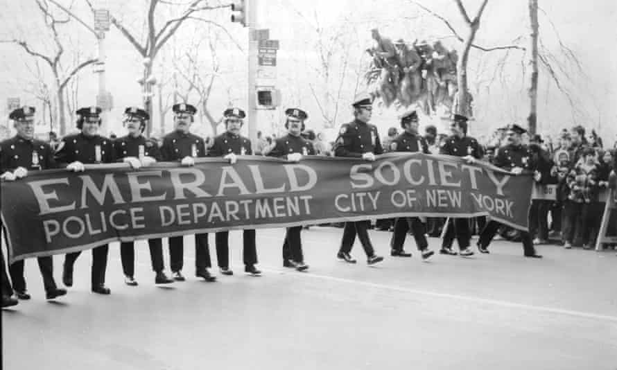 New York City police officers march at the city's St Patrick's Day Parade in March 1975.