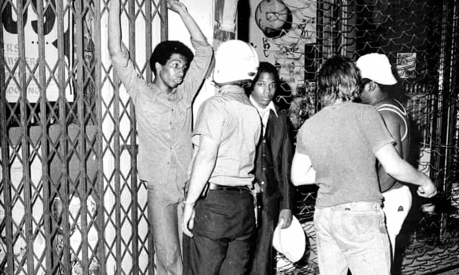 July 1977: during one of the city's many power failures, police challenge suspected looters in the Bronx.