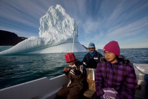 Inuit hunter Nukappi Brandt steers his small boat as he and his daughters scan the water for seals.