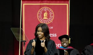 First lady Michelle Obama gives a thumbs up just before delivering the commencement address at Tuskegee University.