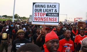 People protest against power cuts during a demonstration in Accra.