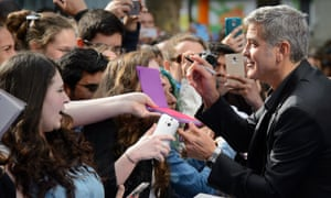 George Clooney works the red carpet at the European premiere of Tomorrowland: a World Beyond in Leicester Square.