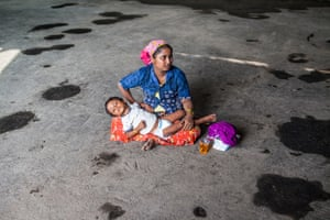 A mother and child seek respite from the sun at the Kuala Langsa refugee camp, where hundreds of migrants are now gathered.