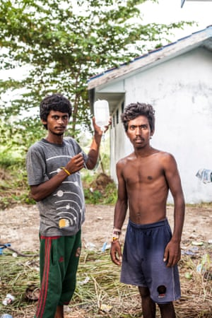 Many of those who have been rescued from vessels have found with serious health conditions. Here a Rohingya man with an intravenous drip tube is walked to the toilets by a companion.