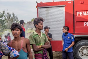 Indonesian volunteers have tacked up toilet cubicles out of thin plywood and a mountain of second-hand clothes has been dumped in the grass.