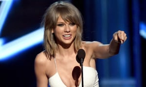 Taylor Swift accepts the Top Hot 100 Artist award onstage during the 2015 Billboard Music Awards.