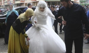 Chechen Kheda Goilabiyeva, is taken by head of the Chechen leader's administration Magomed Daudov to a wedding registry office for her wedding with Chechen police officer Nazhud Guchigov, in Chechnya's provincial capital Grozny, Russia, Saturday, May 16, 2015.