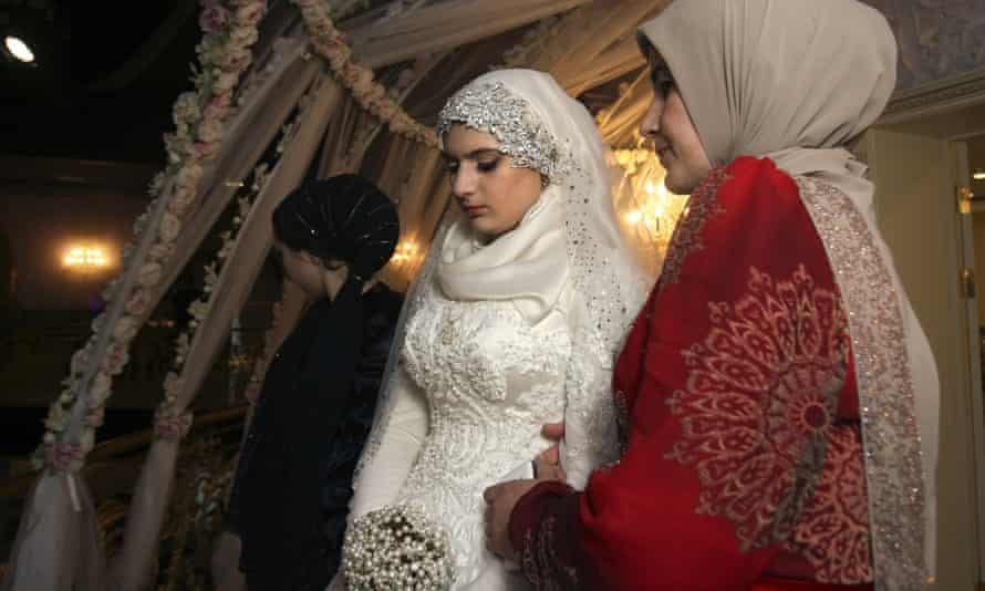 Kheda Goylabiyeva ahead of the ceremony to marry Chechen police officer Nazhud Guchigov.