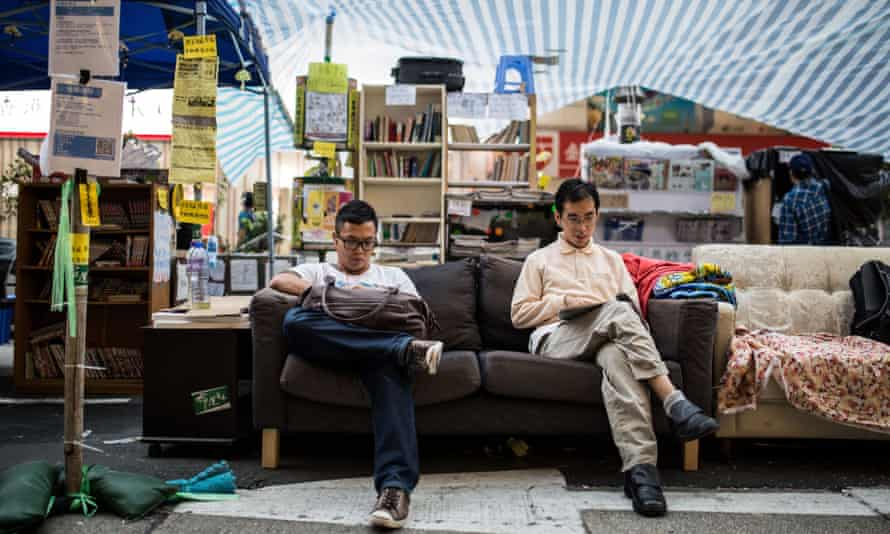 People read at a road library set up by pro-democracy protesters in the Mongkok district of Hong Kong in November 2014.