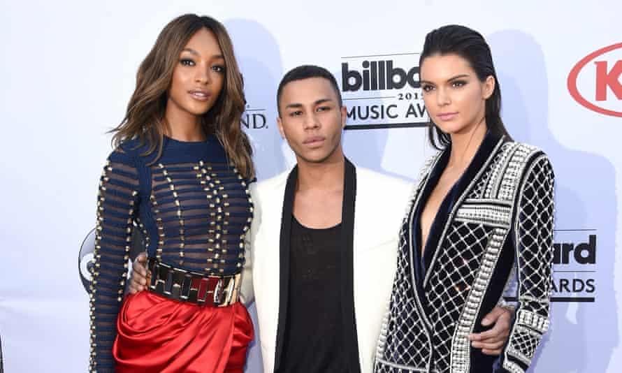 Models Jourdan Dunn and Kendall Jenner with designer Olivier Rousteing in Balmain x H&M