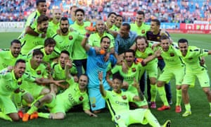 Barcelona's players celebrate winning La Liga after the 1-0 victory at Atlético Madrid.