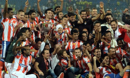 Atlético de Kolkata players celebrate after winning the Indian Super League title in Mumbai in December last year.