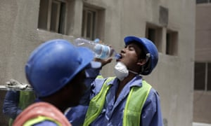 Nischal Tamang, a Nepalese labourer, takes a break from work in Doha, the Qatari capital. Tamang lives in housing listed by inspectors for substandard conditions.
