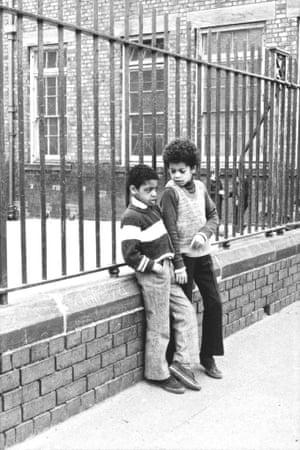 Boys by Windsor Street School railings.