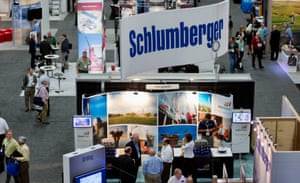 (Schlumberger) Attendees visit exhibit booths at the DUG Eagle Ford Conference & Exhibition in San Antonio, Texas, U.S., on Monday, Oct. 15, 2012.