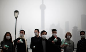 People distributing face masks to pedestrians to raise awareness of air pollution in Shanghai.