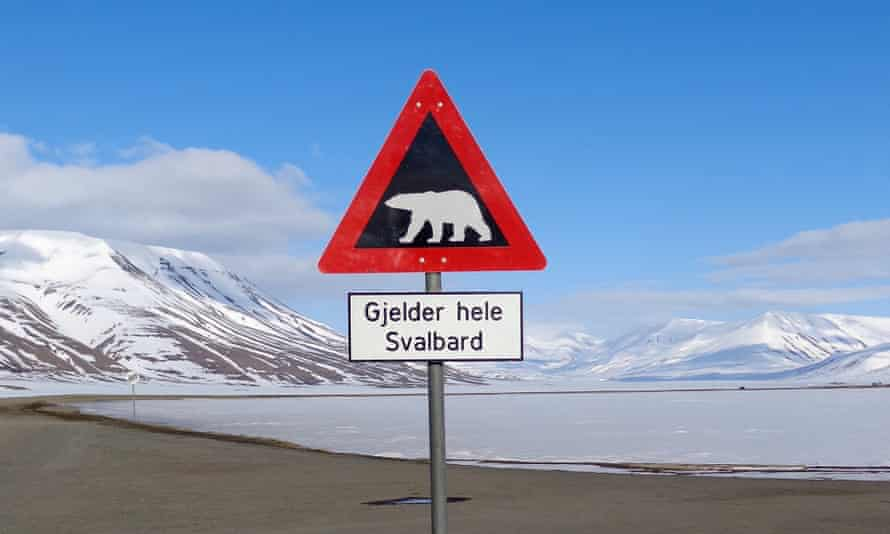 A sign warns residents of the arctic Svalbard islands in Norway of the danger from roaming polar bears, May 26, 2013. The high Arctic, once the irresistible frontier for oil and gas exploration, is quickly losing its appeal as energy firms grow fearful of the financial and public relations risk of working in the pristine icy wilderness.
