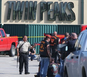 An armed policeman at the scene of the Waco shootout. Photograph: Jerry Larson/AP