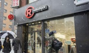 People walk by a New York RadioShack.