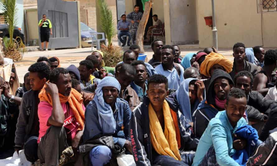 Migrants from sub-Saharan Africa sit at a centre for illegal migrants in the Libyan city of Misrata, as they wait to be transported to a different detention centre.