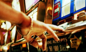A hand operating slot machine  in casino, Las Vegas, Nevada.