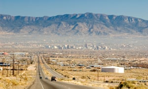 The historic Route 66 highway leading into Albuquerque, with the Sandia Mountains beyond.