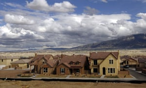 New housing developments spreading through the Albuquerque desert basin.