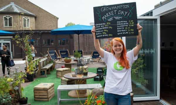 Anthropology student Celia Briseid selling freshly harvested vegetables at Growhampton's weekly market day.