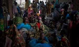 Burundian refugees wait for assistance at Bugesera camp in Rwanda on 2 May 2015.