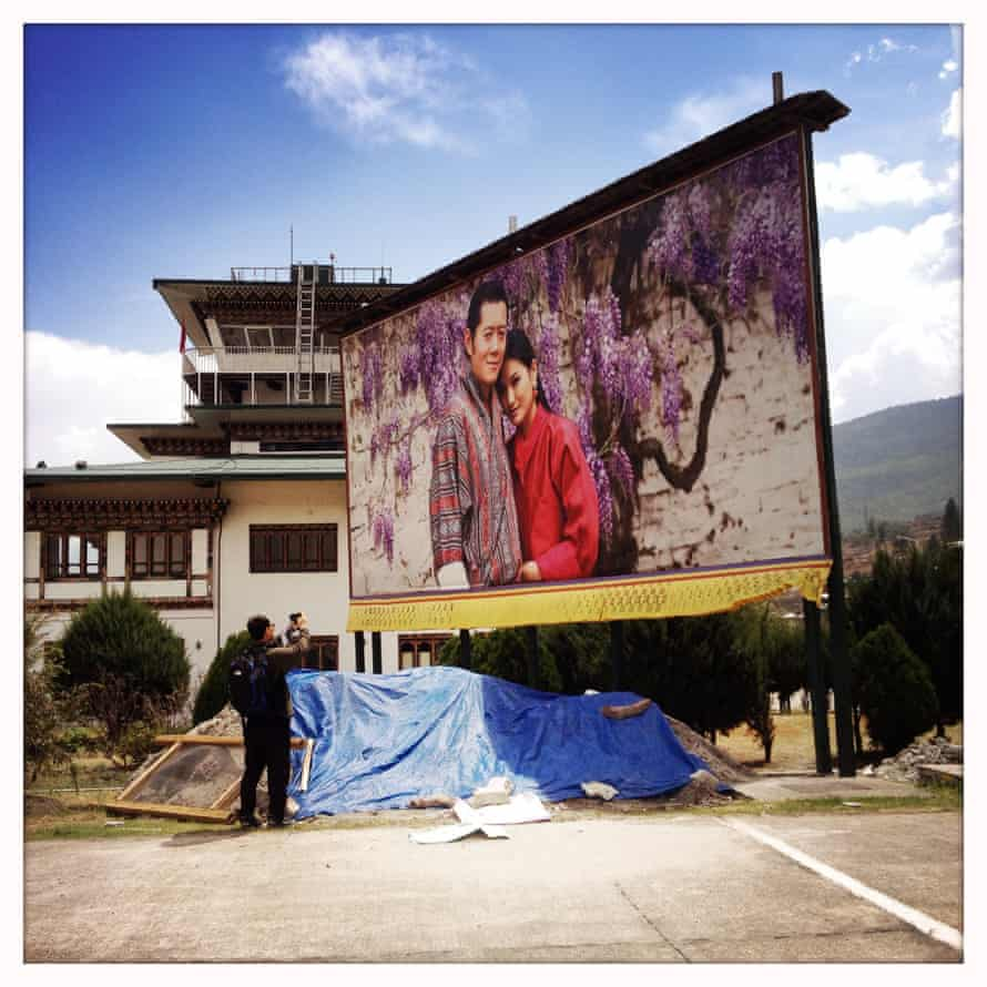 A large billboard of Bhutan's king and queen