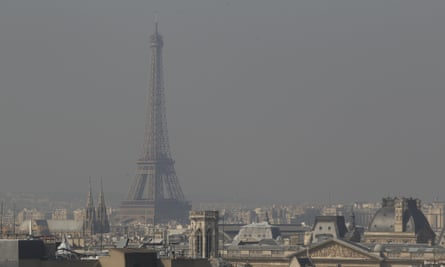 A view of the Eiffel Tower and the city surrounded by high levels of air pollution on March 23, 2015 in Paris, France. Paris authorities have introduced emergency measures to help control pollution levels, such as alternate driving days in Paris, limiting cars to 20 kilometers per hour and vehicles with number plates ending in an even number will be banned from the roads of Paris and surrounding suburbs.