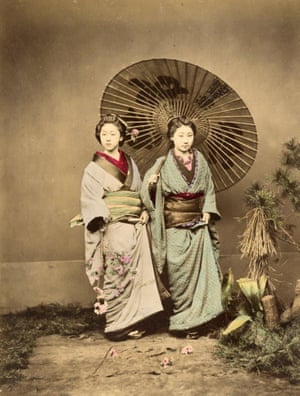 Two women with an umbrella