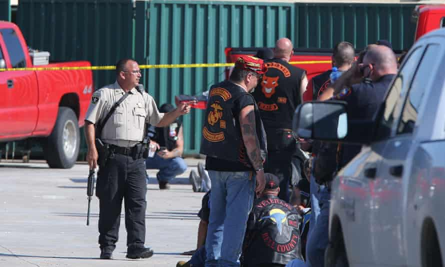 Authorities investigate a shooting in the parking lot of the Twin Peaks restaurant in Waco, Texas.