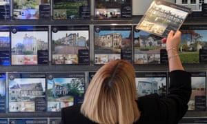 A woman looking at houses for sale in Edinburgh.
