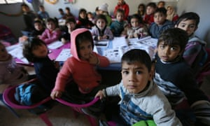 Syrian children attend a class at a school for refugees in the Lebanese village of Qaraoun, in the Bekaa Valley.