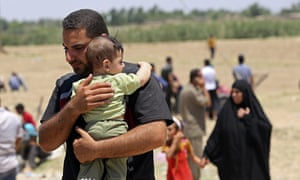 Displaced Iraqis from Ramadi flee their hometown after it was seized by Isis.