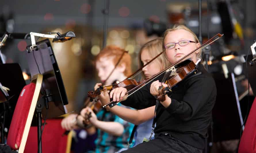 Children from the Raploch housing scheme rehearse for an outdoor concert with Gustavo Dudamel and The Simon Bolivar Symphony Orchestra of Venezuela in Stirling, June 2012.