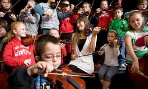 Scottish violinist Nicola Benedetti at Raploch Community Campus with children from Raploch's Big Noise orchestra.