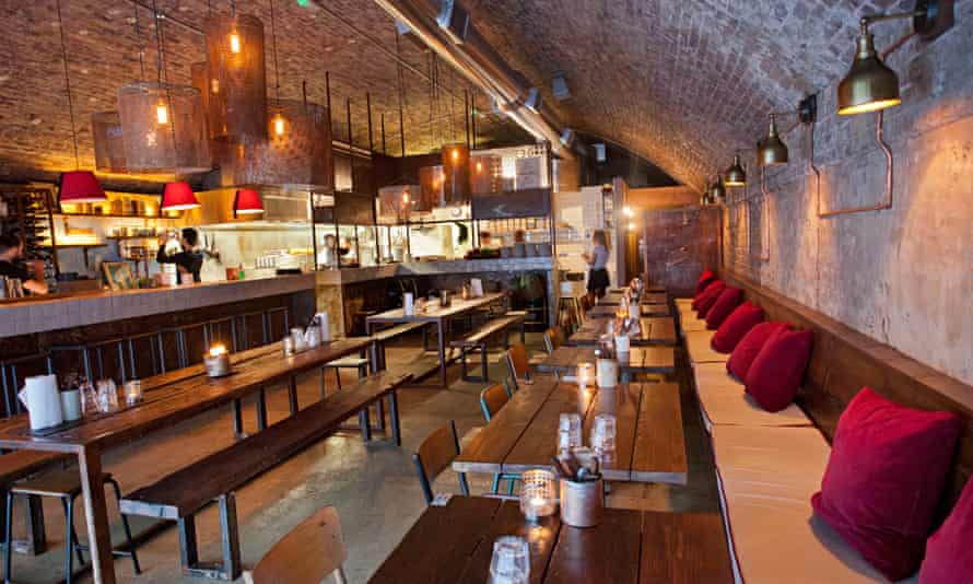 The brick-vaulted-ceiling and banquette and benches at Berber & Q