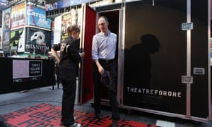 An audience member steps out of the Theatre for One performance space in New York's Times Square in 2011.