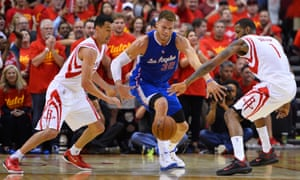 Los Angeles Clippers player Blake Griffin loses the ball against Houston Rockets players