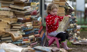 HAY-ON-WYE, WALES - MAY 28:  Maeve Magee, 3, reads a book during the Hay Festival on May 28, 2014 in Hay-on-Wye, Wales. The Hay Festival is an annual festival of literature and arts which began in 1988.  (Photo by Matthew Horwood/Getty Images)Human InterestLeisure ActivityLifestyles