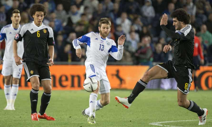 Israel's midfielder Sheran Yeini vies with Belgium's midfielder Marouane Fellaini during their recent Euro 2016 qualifying football match.
